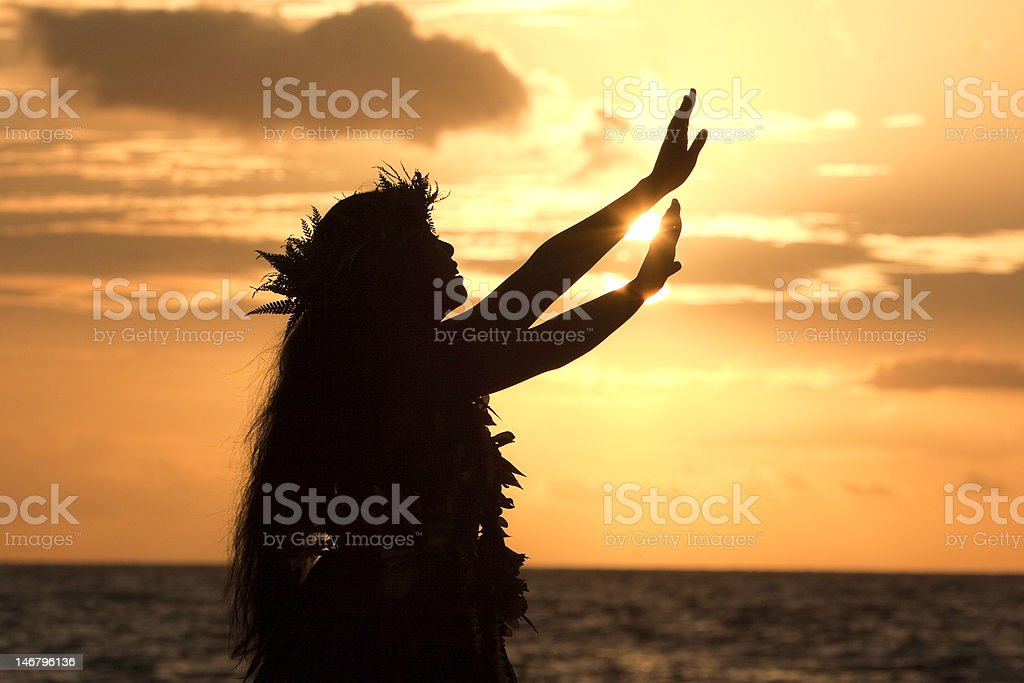 Hula girl reaches for the sun stock photo