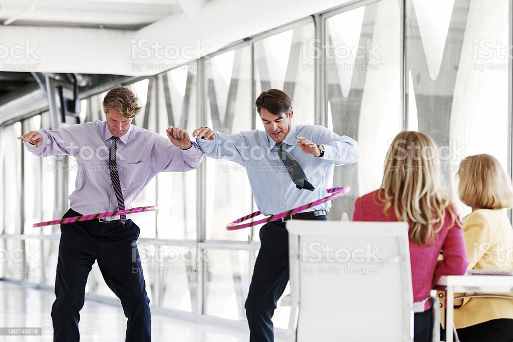 Hula hoop initiation at the office stock photo
