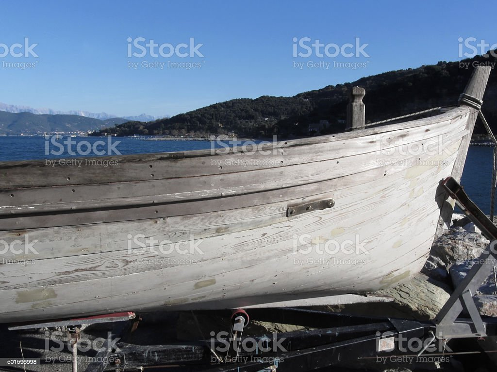 Hull of wooden fishing boat under repair in dry dock stock photo