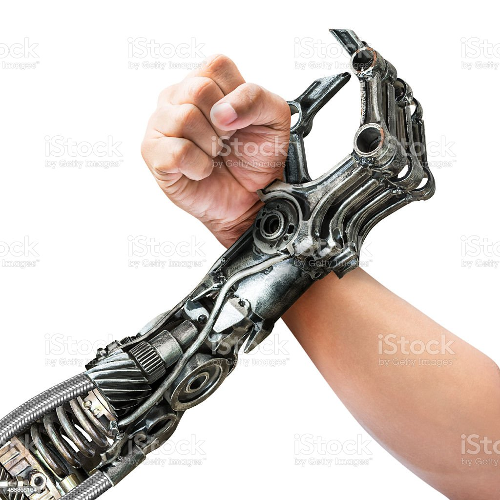 Human and robot arm wrestling stock photo