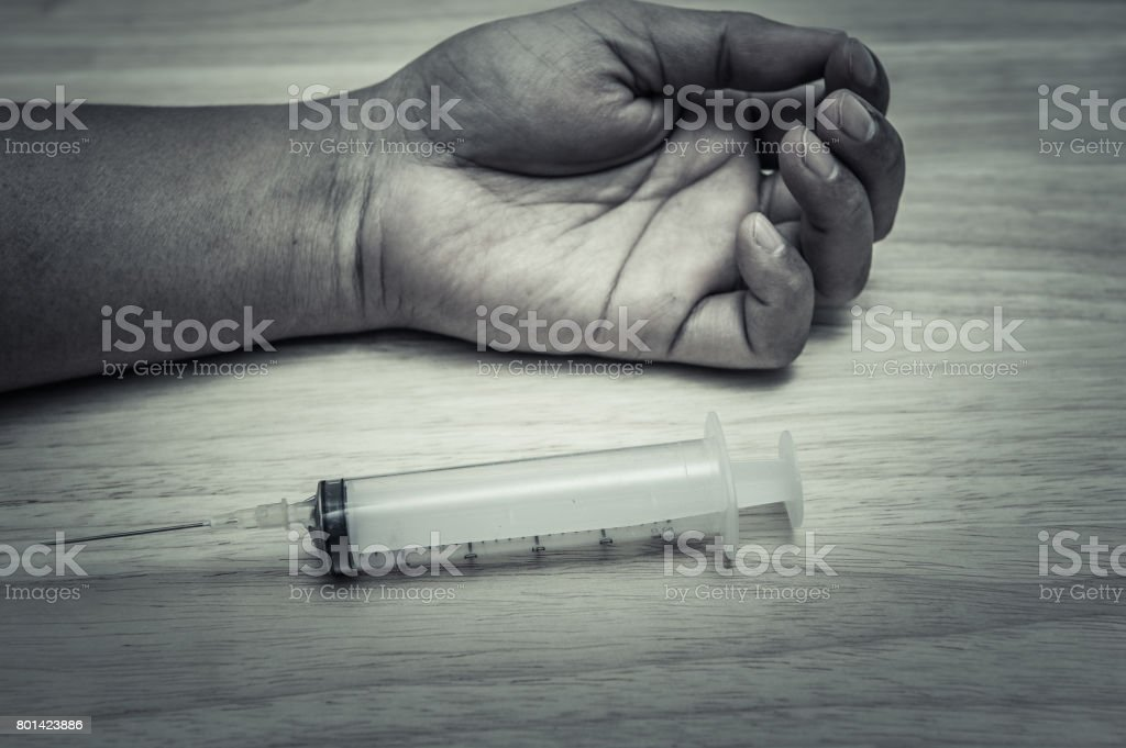 Human arm and syringes stock photo