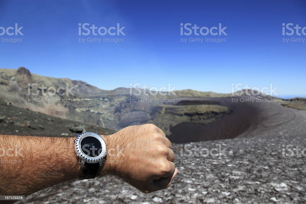 Human Arm Showing Altimeter at Villarrica Volcano Summit stock photo