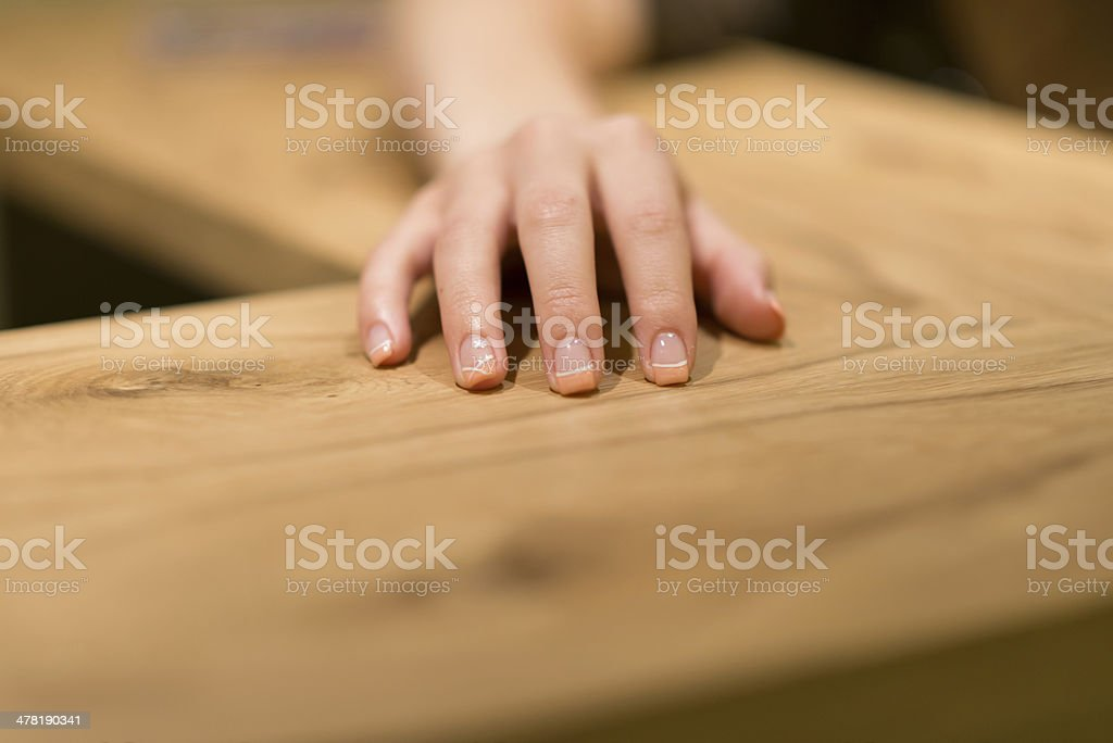 human beautiful  hands on wooden surface stock photo