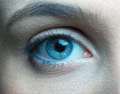 Human blue eye close up