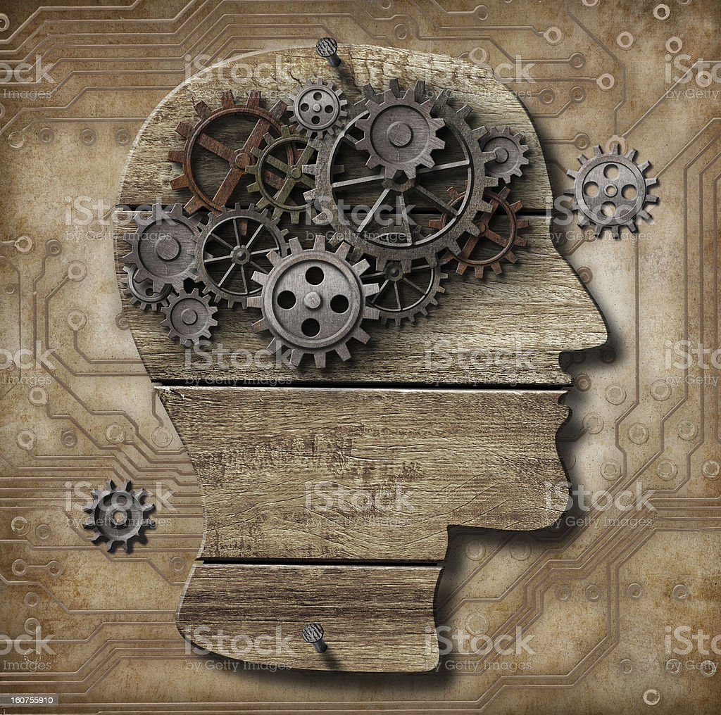 Human brain made of rusty metal gears and hogs royalty-free stock photo