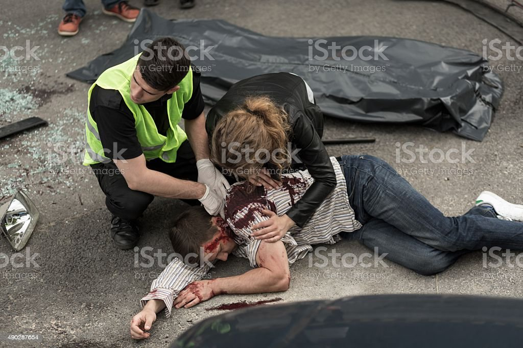 Human corpse on the street stock photo