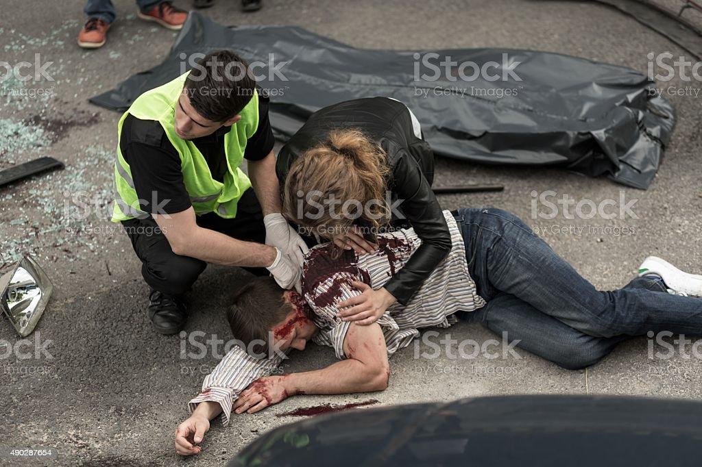 Human corpse on the street stock photo