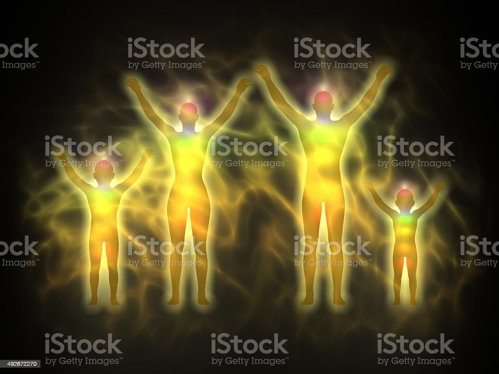 Human energy body silhouette with aura and chakras - family stock photo