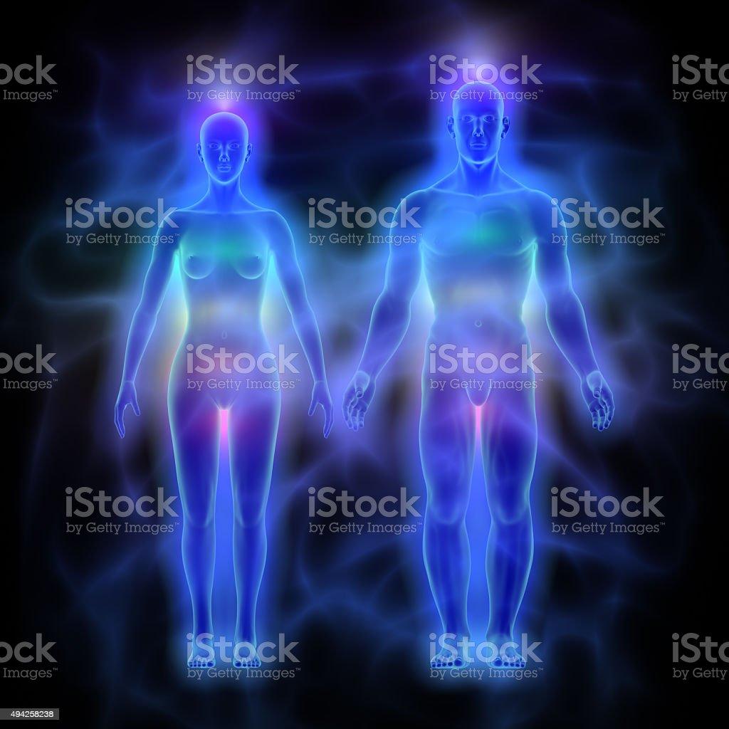 Human energy body (aura) with chakras - woman and man stock photo