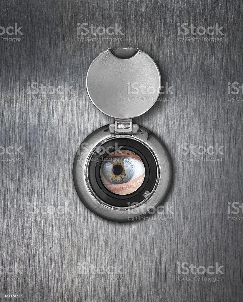 Human eye in peep hole closeup royalty-free stock photo