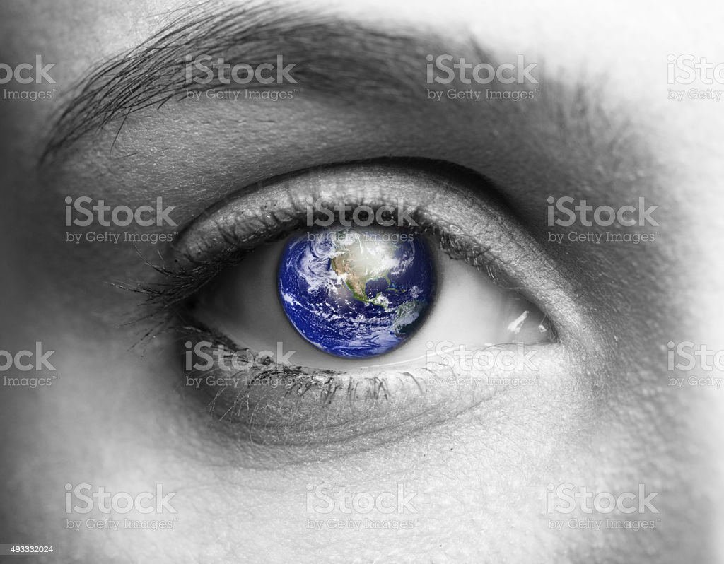 Human eye with earth close up stock photo