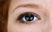 Human eye with radiation hazard symbol - concept photo.