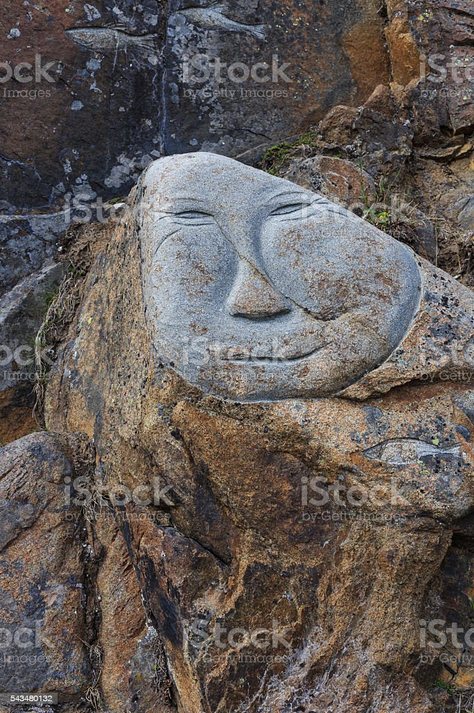 human face smile on stone cave stock photo