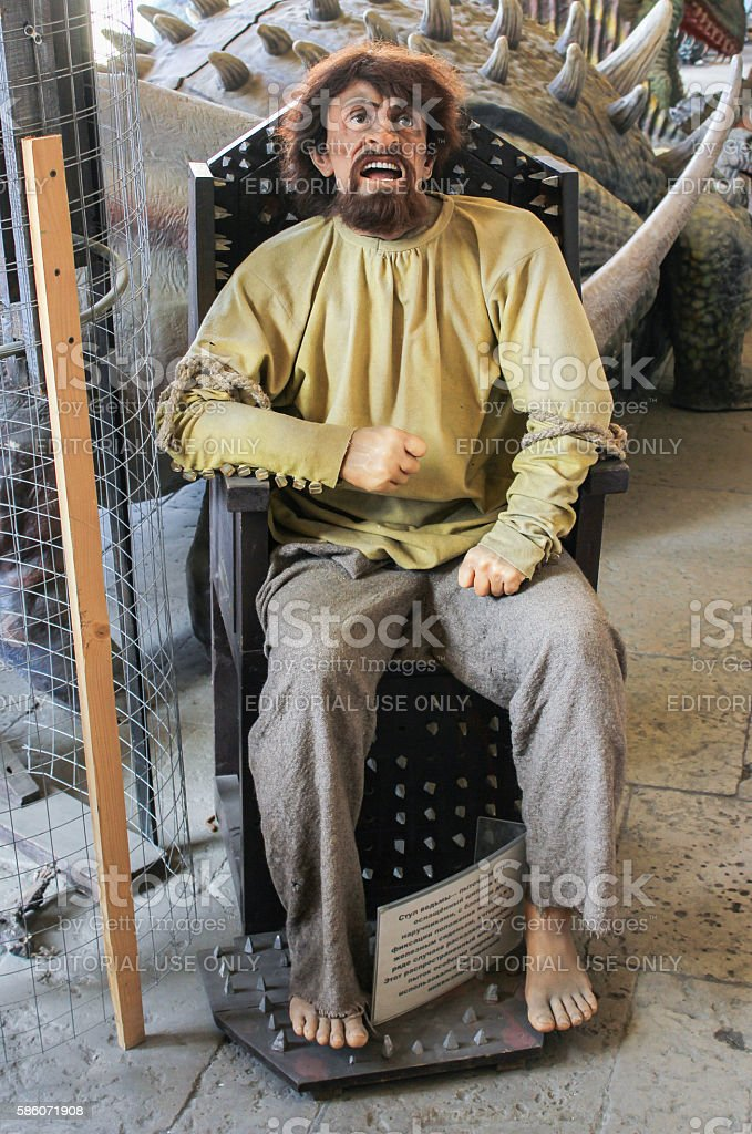 Human figure in the chair of torture. stock photo
