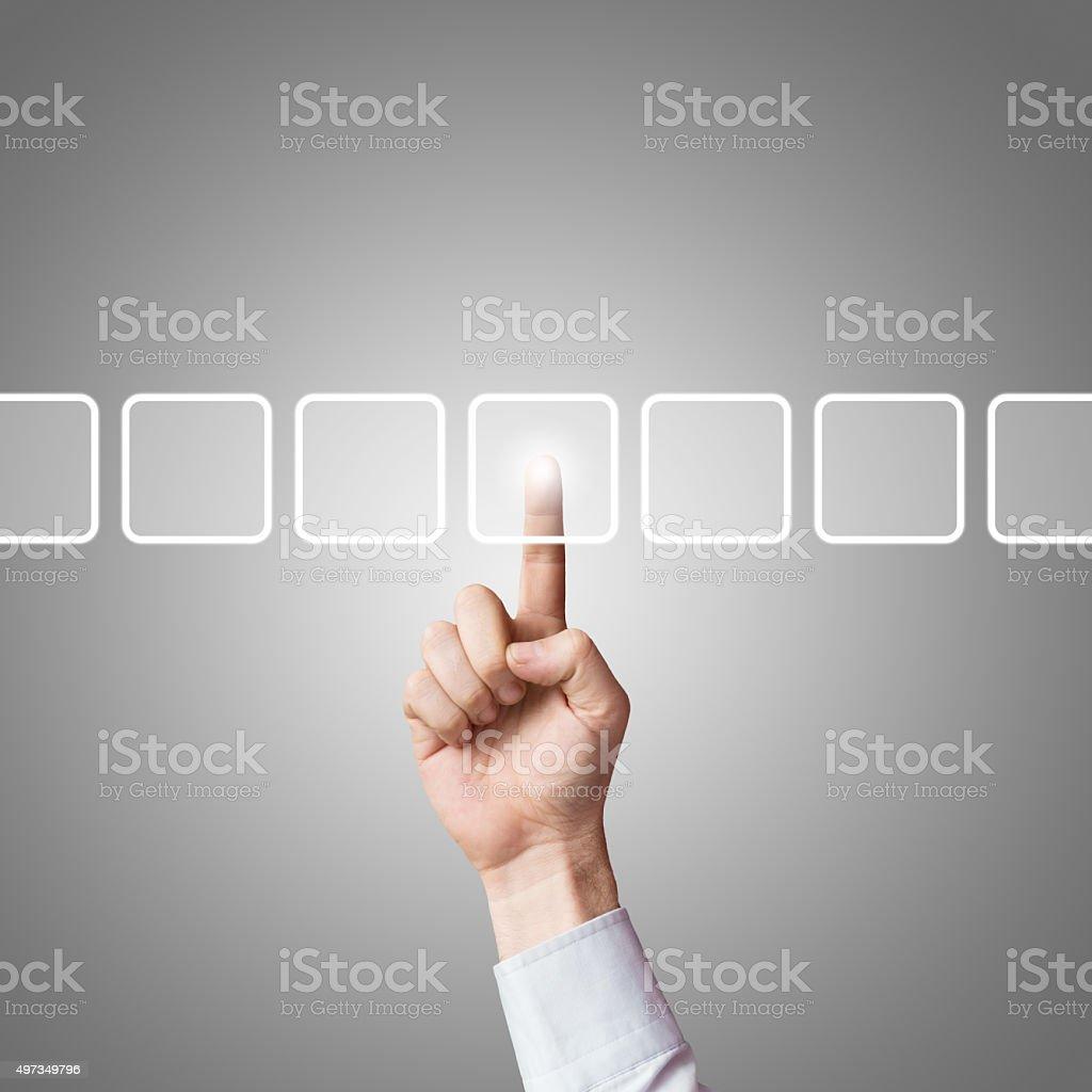 Human finger choosing a button on visual screen stock photo