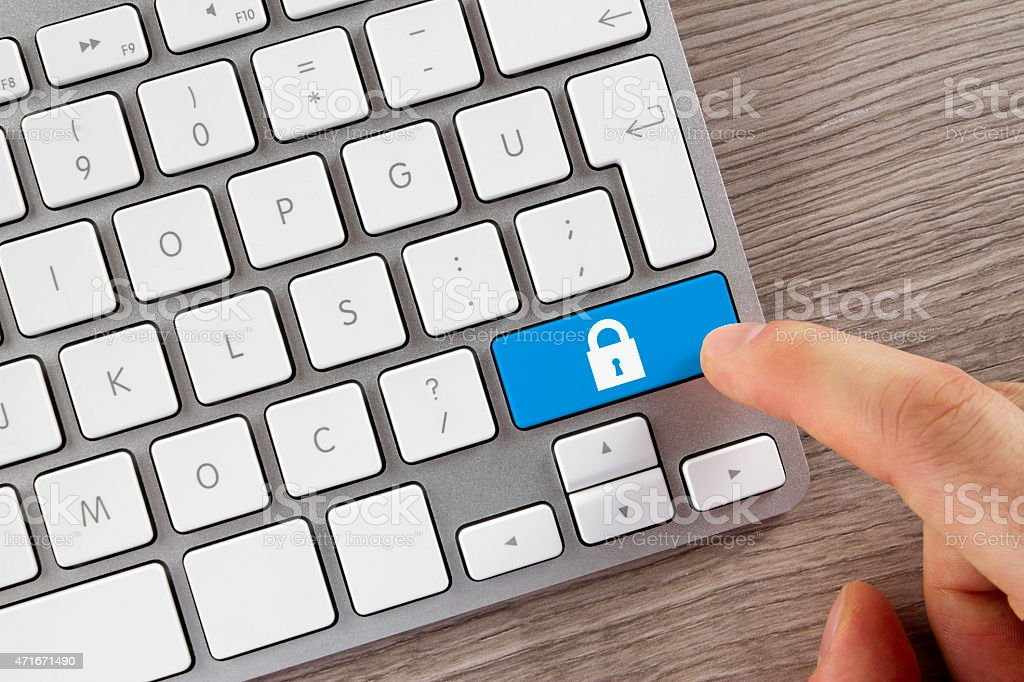 Human Finger is Pushing Security Button on Keyboard stock photo