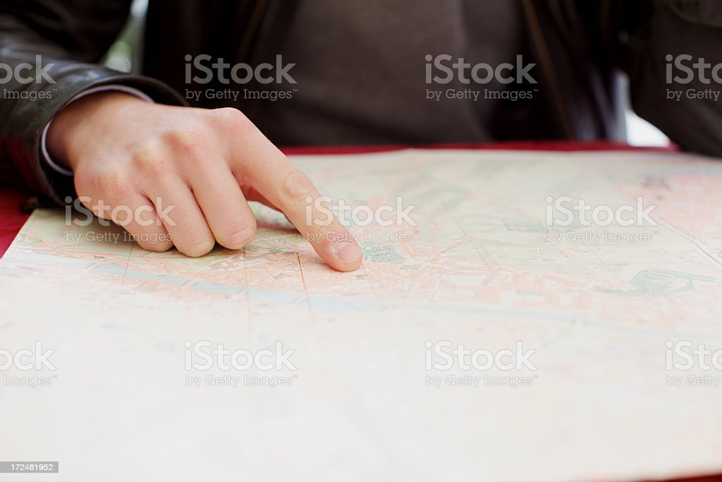 Human finger pointing the map royalty-free stock photo