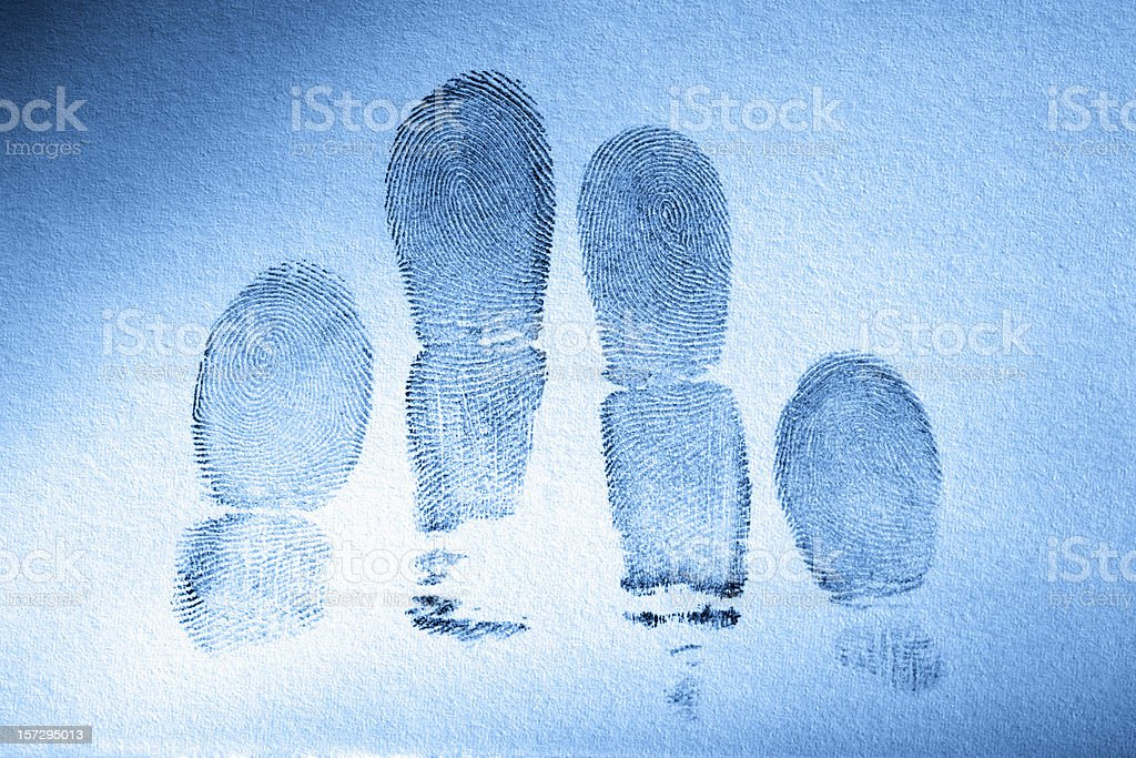 Human fingerprints with a blue tint to the page royalty-free stock photo