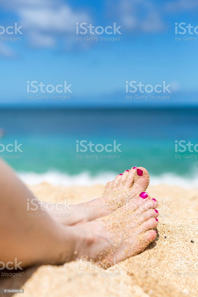 Human Foot on Tropical Sand Beach, Sunset Beach, Oahu, Hawaii stock photo