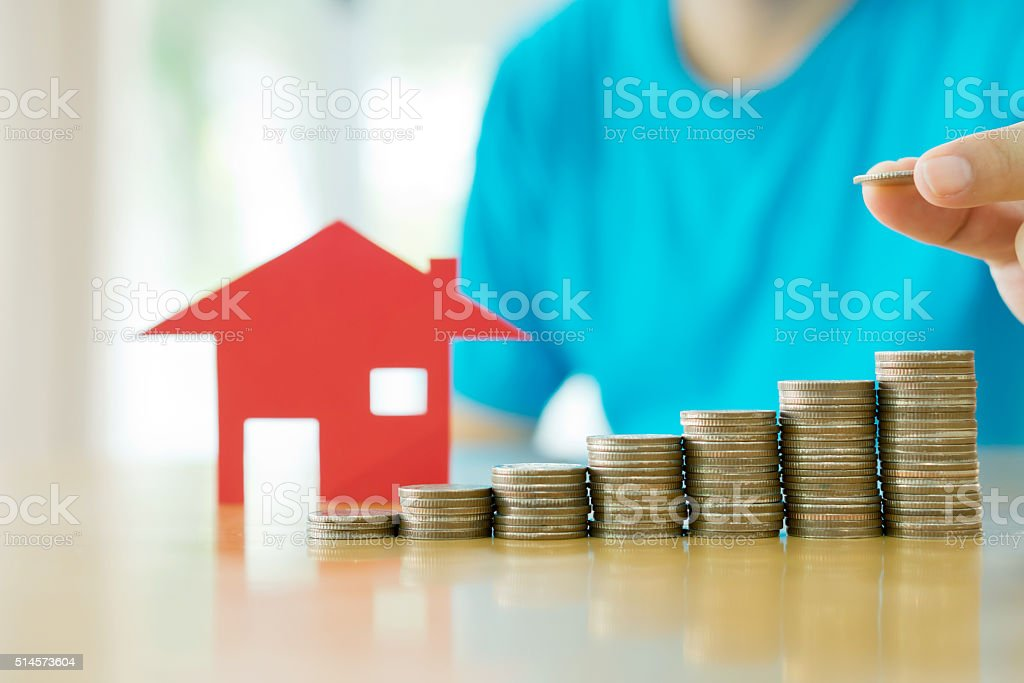 Human hand add a  coin in the final row stock photo