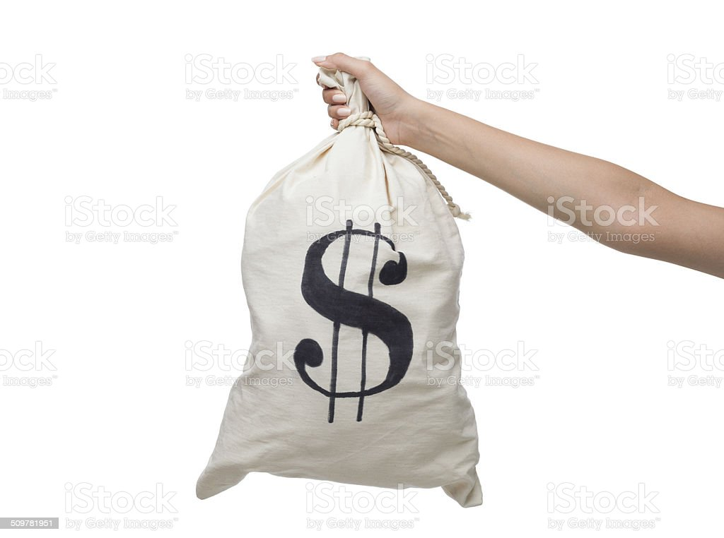 Human hand carrying money bag with dollar sign stock photo