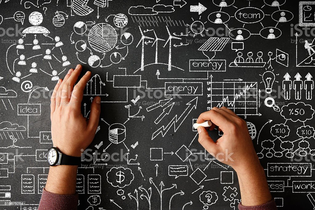 Human hand drawing business strategy on black desk stock photo