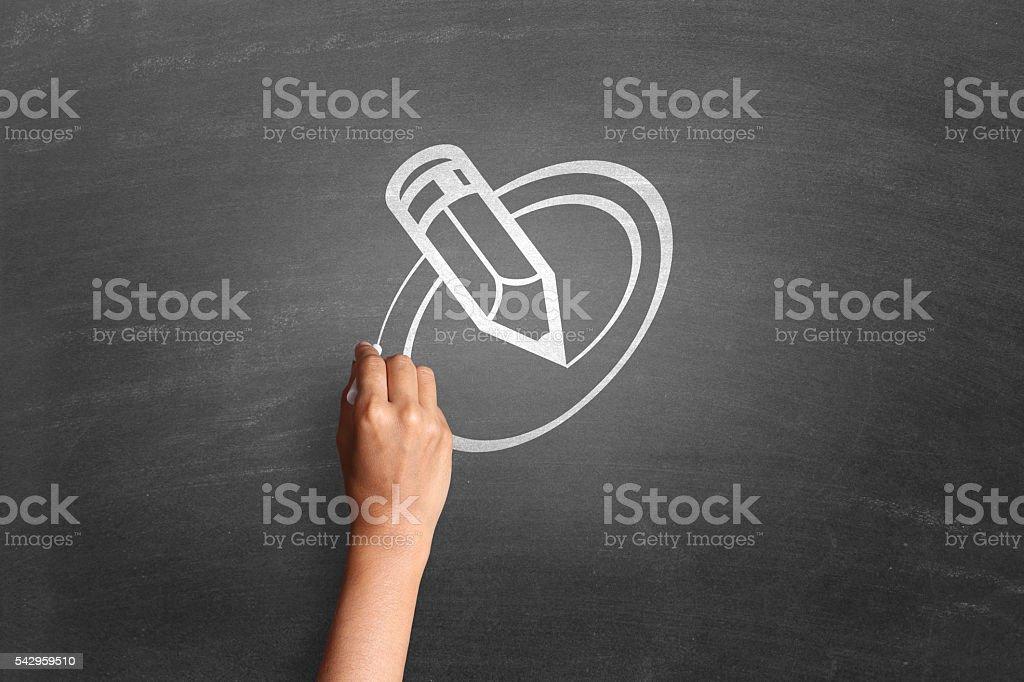 Human hand drawing pencil on blackboard stock photo