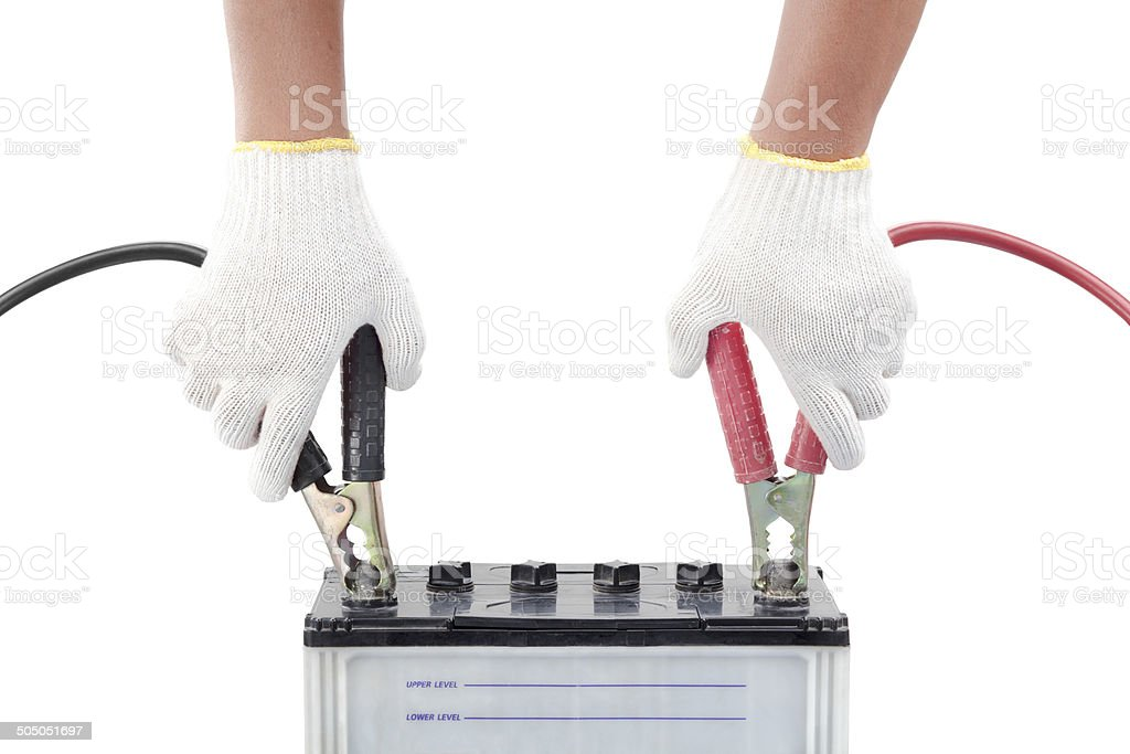 Human hand giving to charge battery stock photo