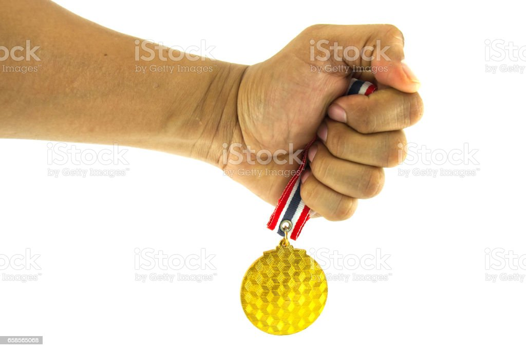 Human hand hold the gold medal on white background stock photo