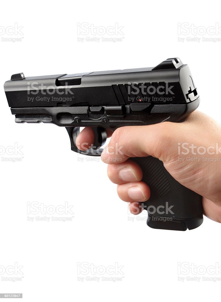 Human Hand Holding 9mm gun royalty-free stock photo