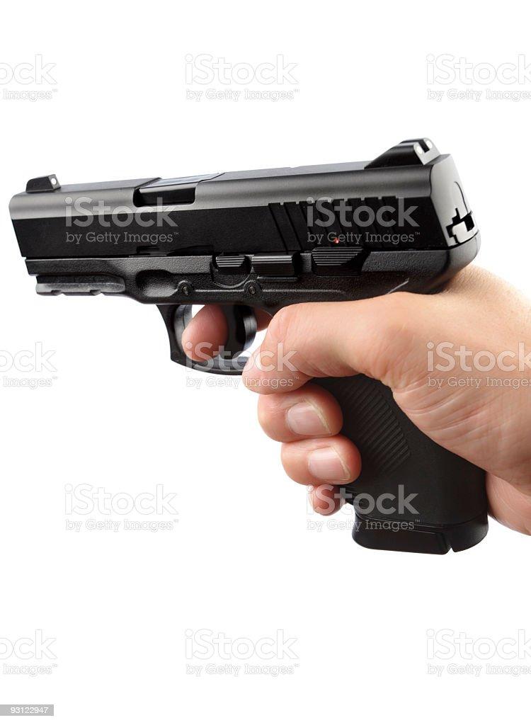 Human Hand Holding 9mm gun stock photo