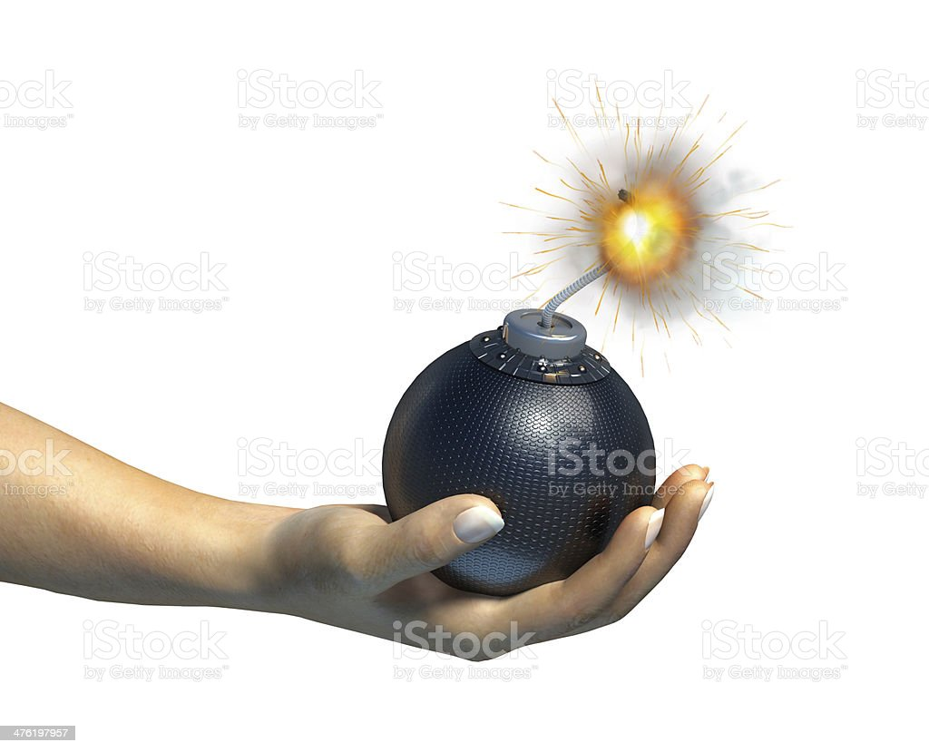 Human hand holding a bomb with burning fuse royalty-free stock photo