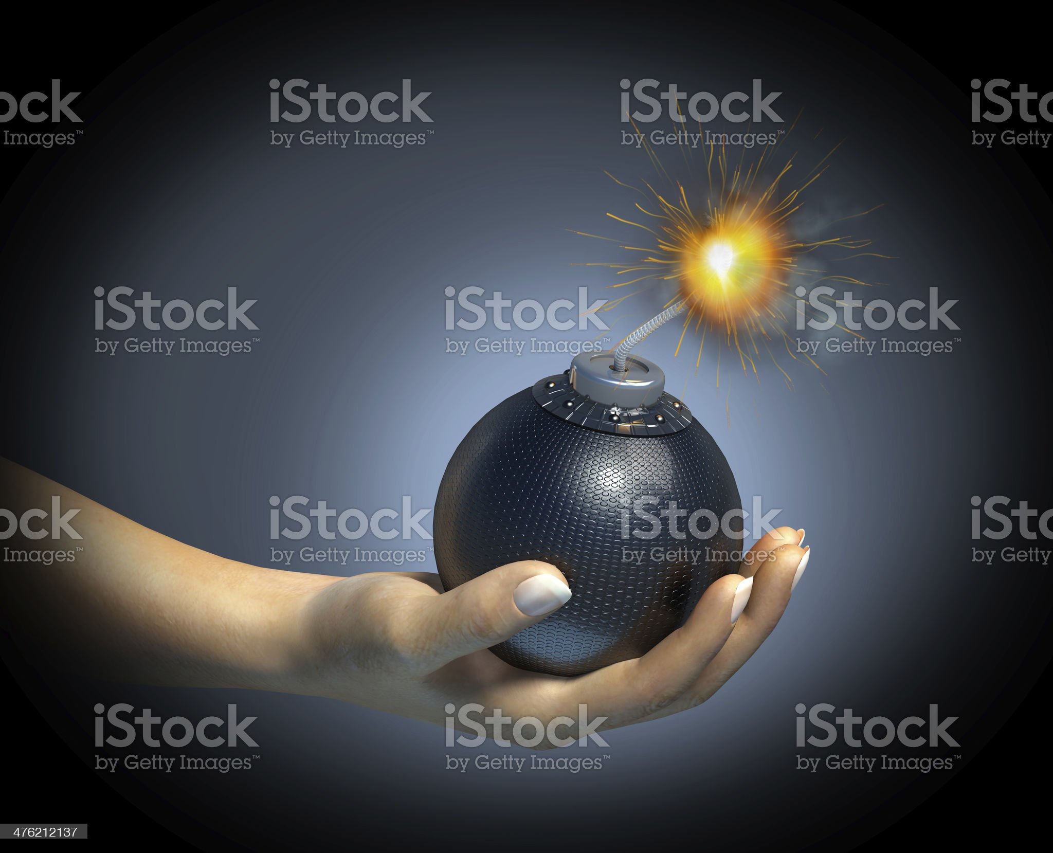 Human hand holding a bomb with burning fuse. royalty-free stock photo