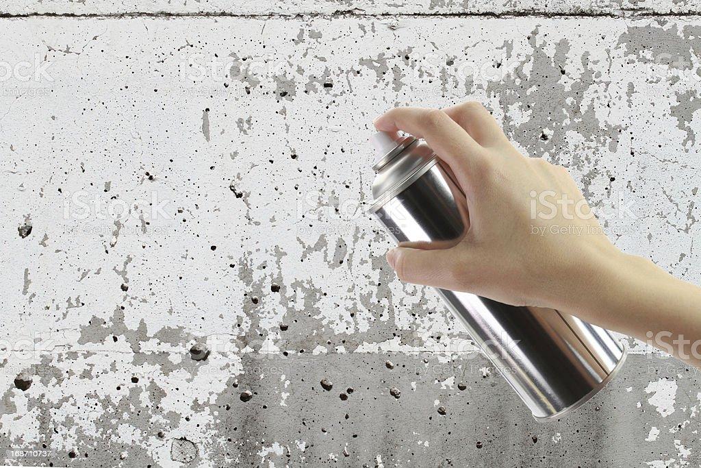 Human hand holding a graffiti Spray can stock photo
