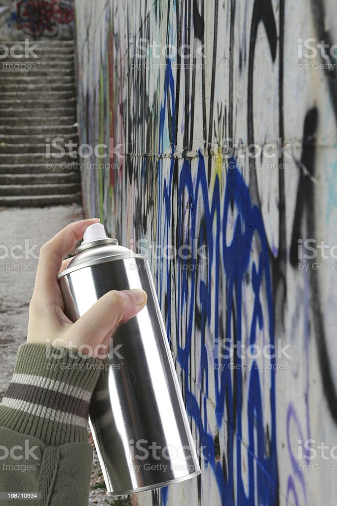 Human hand holding a graffiti Spray can royalty-free stock photo