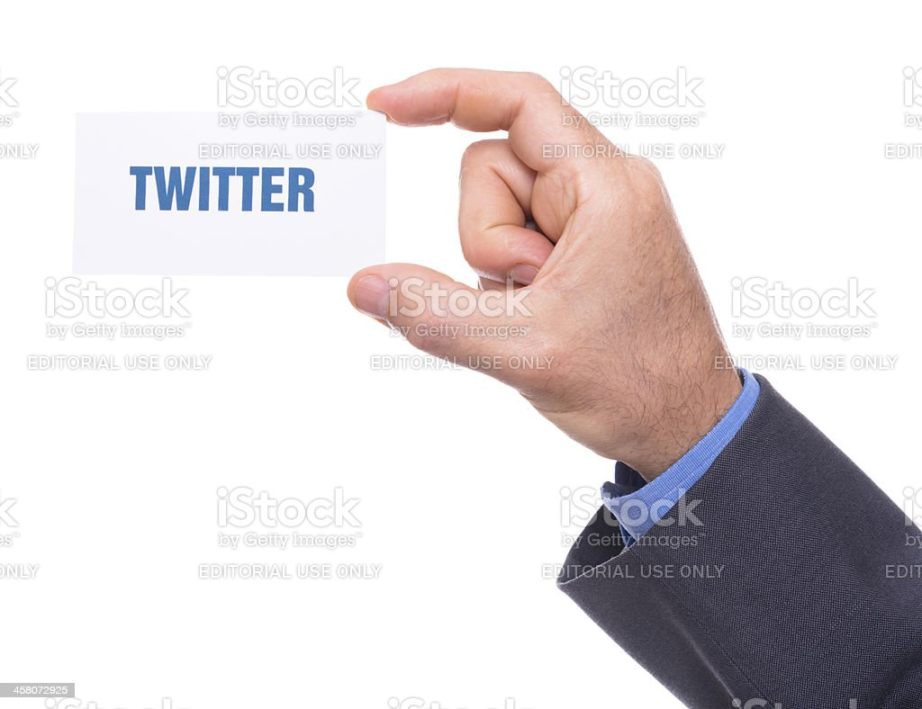 Human hand holding a greetings card with 'twitter' text royalty-free stock photo