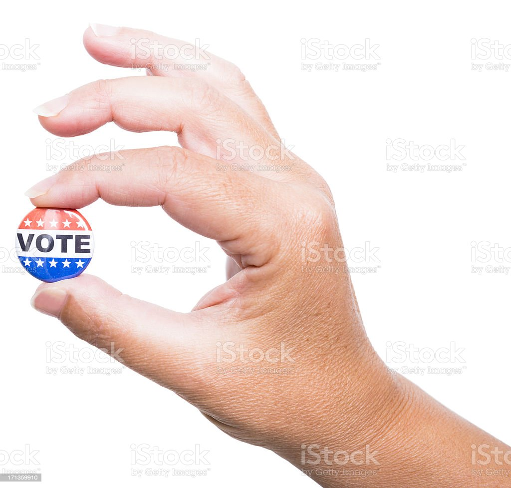 Human hand holding a Vote badge isolated on white royalty-free stock photo