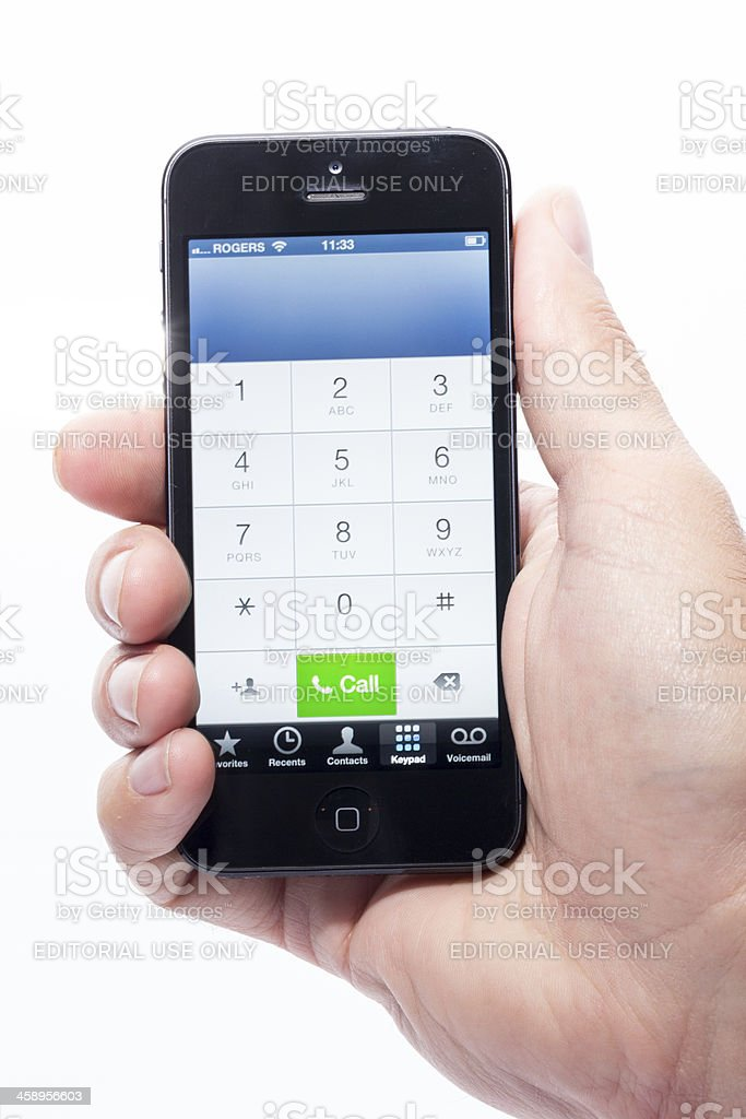 Human Hand Holding Apple iPhone 5 Call Screen Isolated royalty-free stock photo