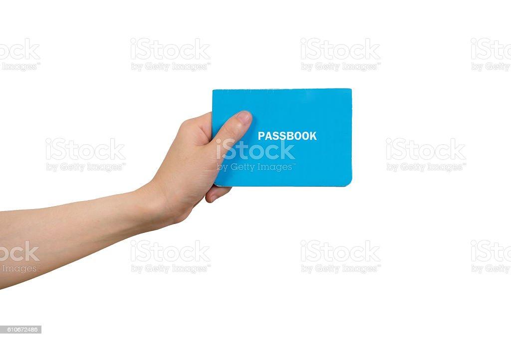human hand holding blue passbook on isolated white background. stock photo