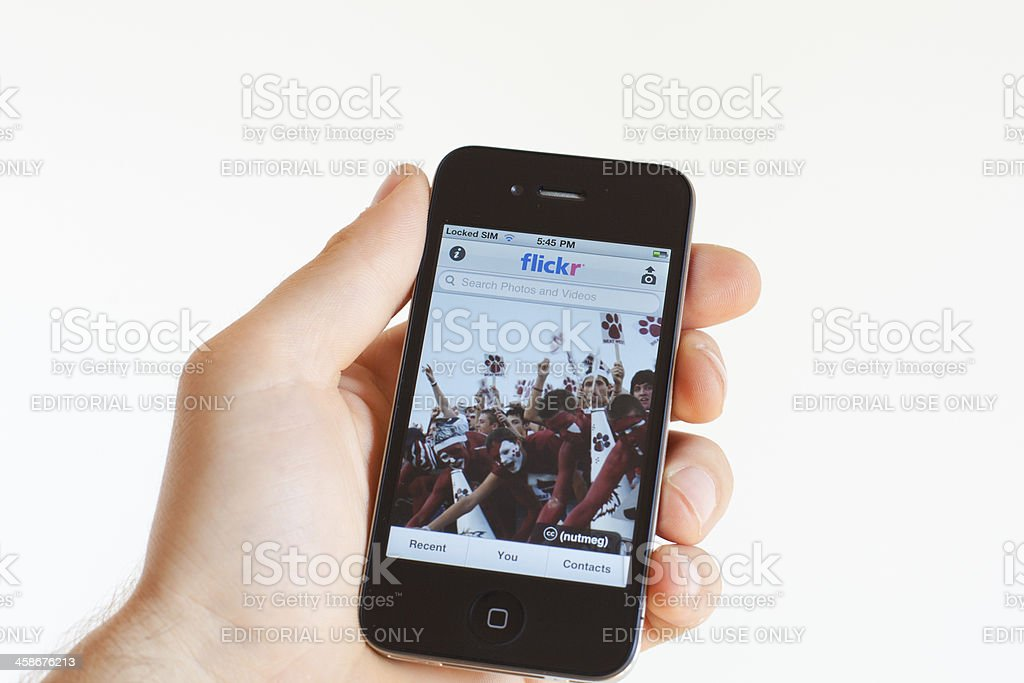 Human Hand Holding Iphone 4 with Flickr Application royalty-free stock photo