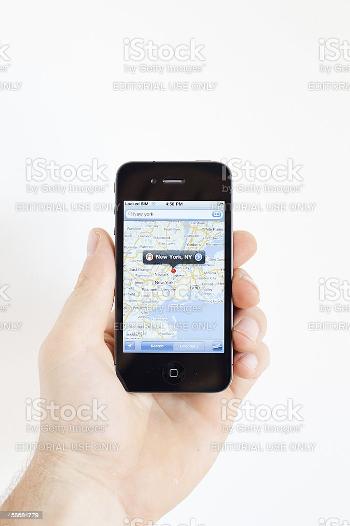 Human Hand Holding Iphone 4 with Google Maps stock photo