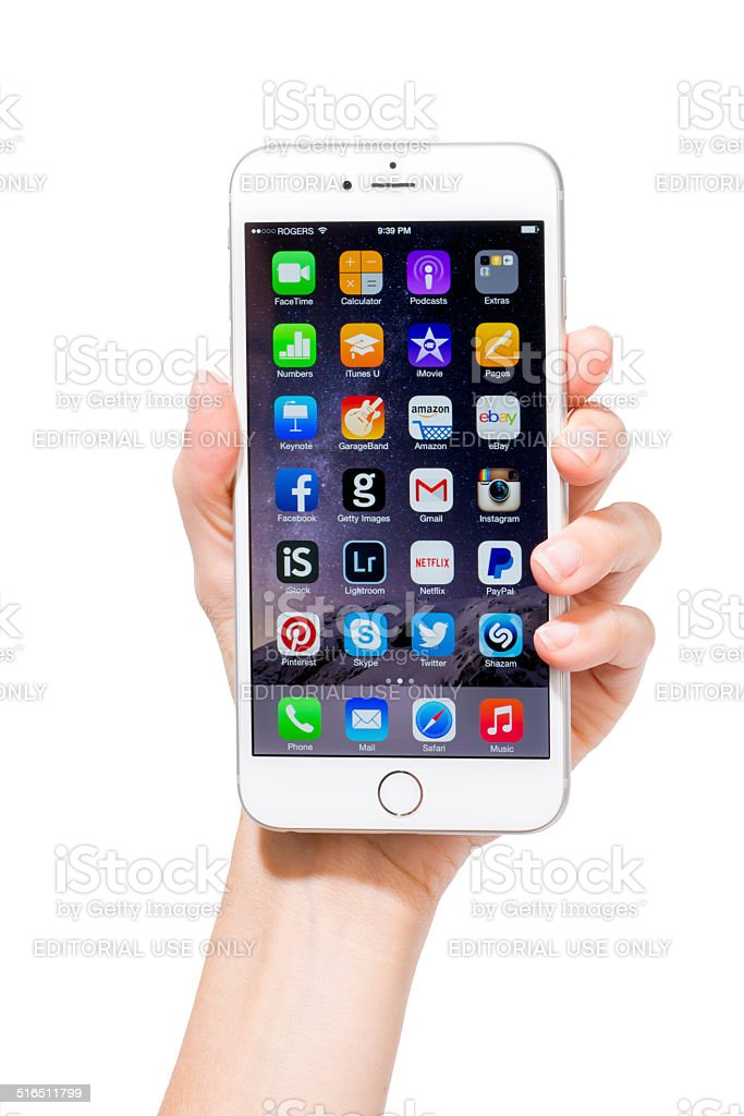 Human Hand Holding Iphone 6 Plus with Home Screen isolated stock photo