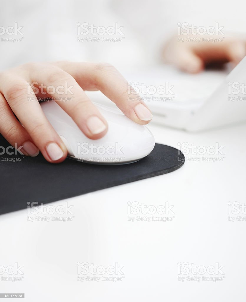 Human hand holding laptop mouse royalty-free stock photo