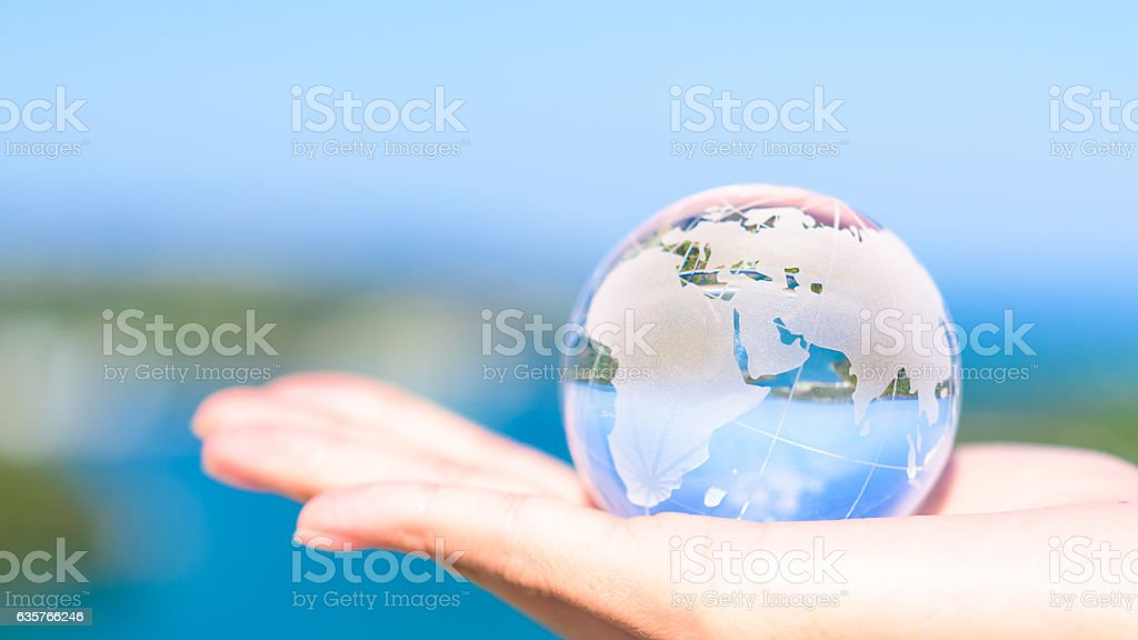 Human hand holding planet earth. stock photo