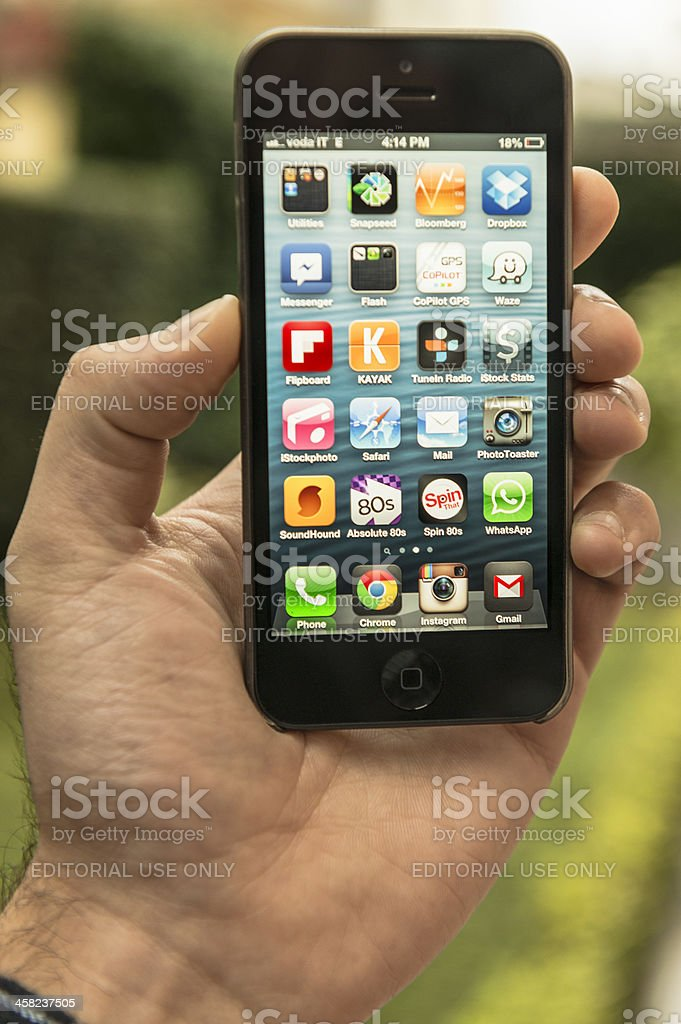 Human hand holding the new Apple iphone 5 royalty-free stock photo