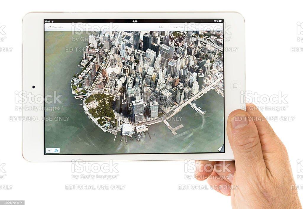 Human hand holding the new Ipad Mini Apple maps app stock photo