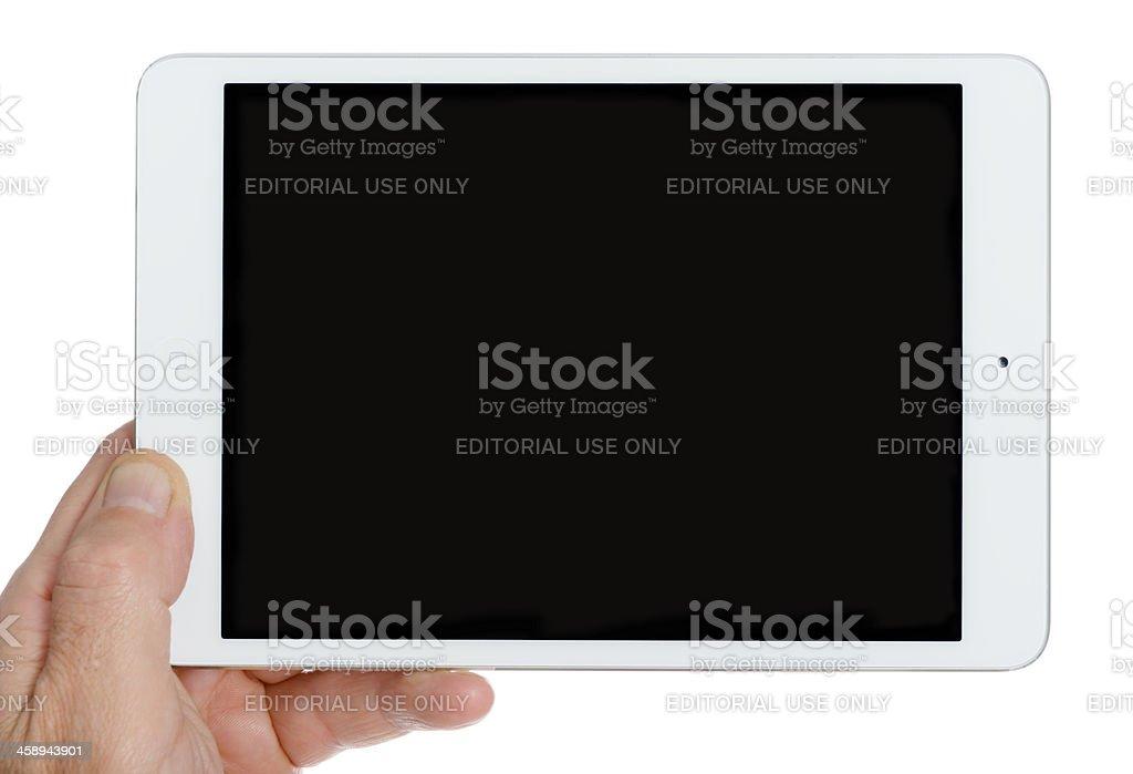 Human hand holding the new Ipad Mini stock photo