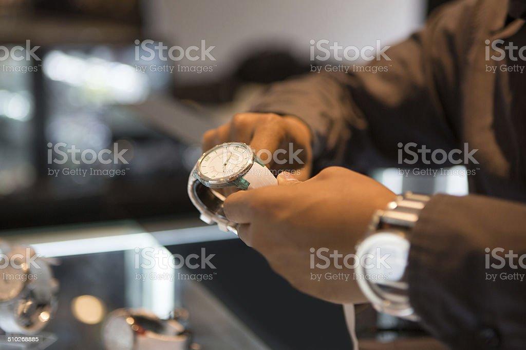 Human hand holding watch stock photo