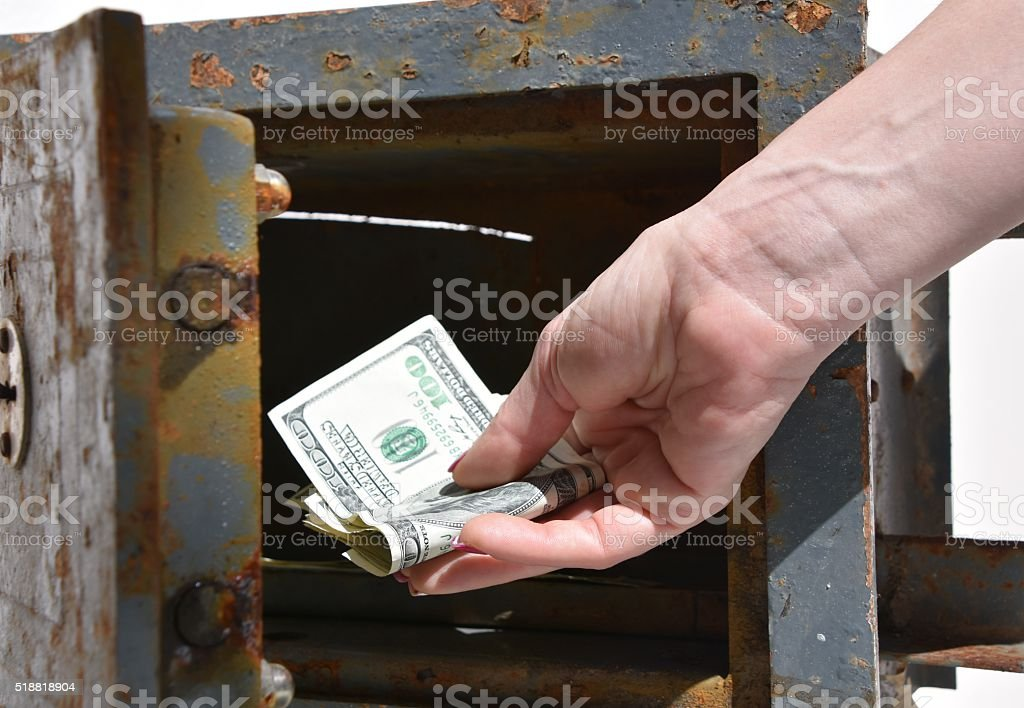 Human hand in a Deposit Box stock photo