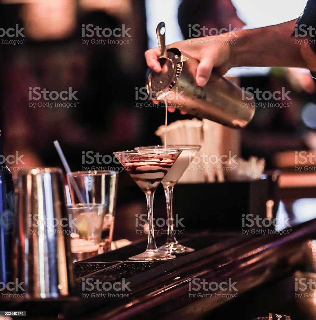 Human hand making cocktails with bokeh background. stock photo
